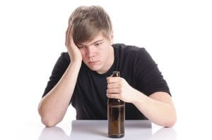 young teen boy suffering from teen alcohol abuse