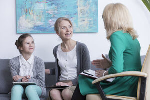 mom and daughter in family counseling for addiction