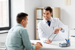 doctor with tablet shows patient the benefits of rational emotive behavioral therapy