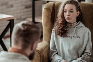 young woman learns about cognitive behavioral therapy
